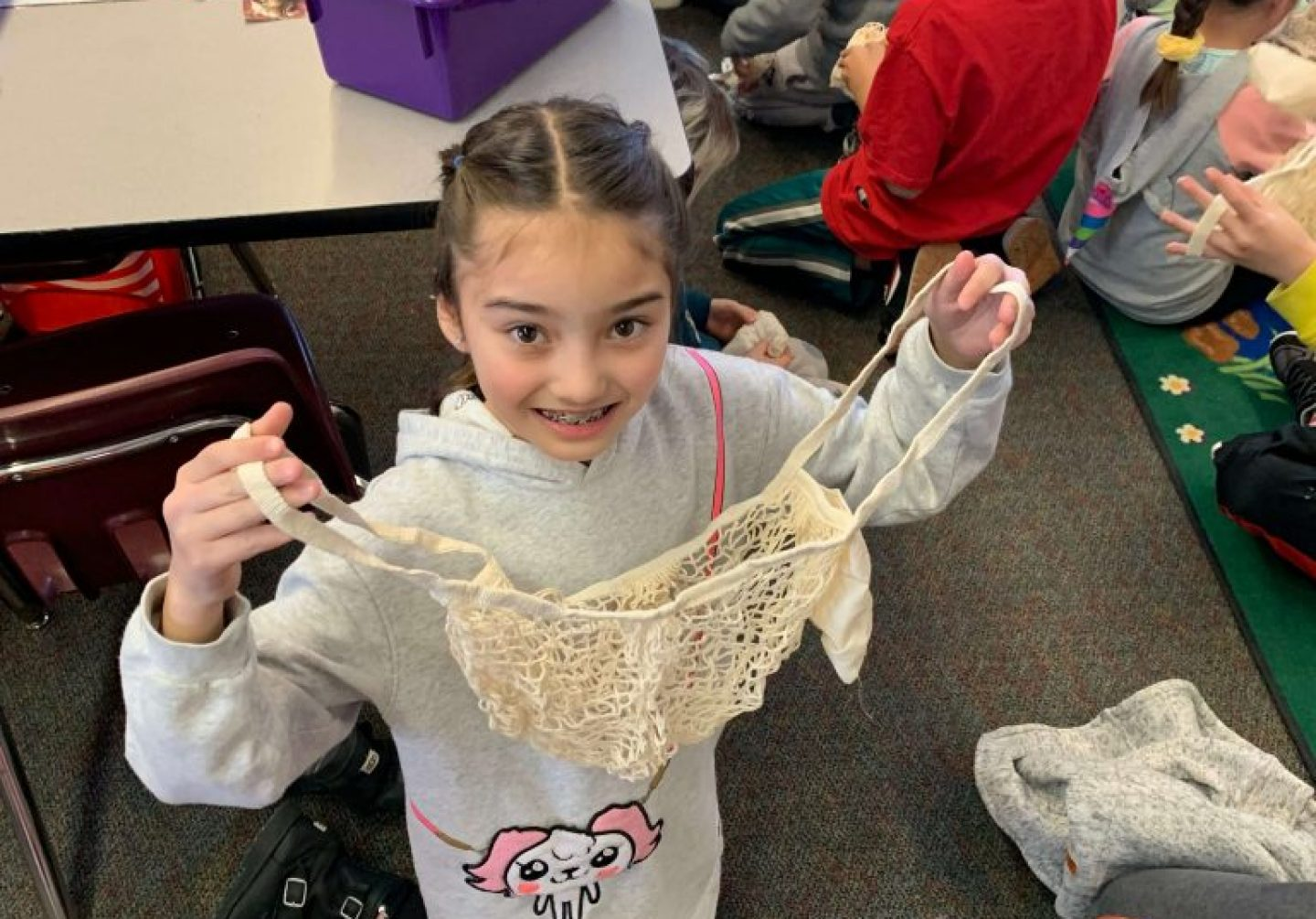 Girl holding UnEARTH Netted Bag