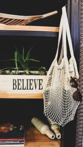 UnEARTH Netted Bag with the word 'believe' behind